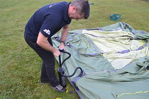 Pitching an inflatable tent