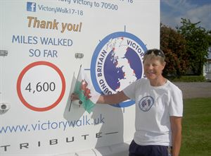 Jane Allen celebrates reaching a new mileage total during her charity trek