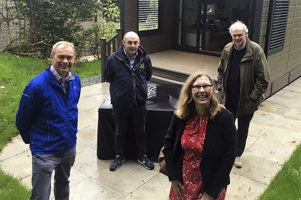 Meeting at the park were Gill Haigh, managing director of Cumbria Tourism, and (from left) Tim Farron MP, Skelwith Fold's Henry Wild, and Cllr Robin Ashcroft