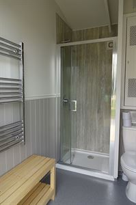 Heated towel rails and changing benches are included