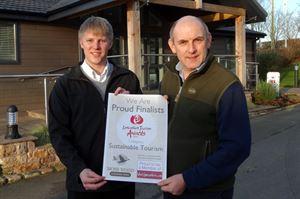 Marketing co-ordinator Neil Darby (left) and park owner Henry Wild receiving the award