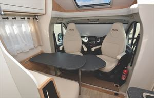 The lounge and cab in the Pilote P650C Evidence motorhome