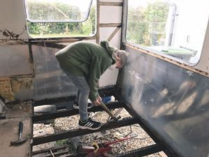 Removing the floor of the caravan