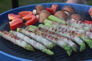 Asparagus wrapped in ham, cooking on a Campingaz Party Grill (photo by Iain Duff)