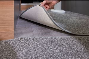 The Adamo ranges features 'Dove Grey' split section loose fit drop in carpets above textured finished durable floor vinyl