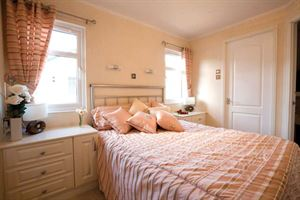 The master bedroom in the latest Stately-Albion Carmarthen park home