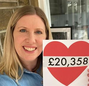 Laura Wilby, Associate Director of Caravan Guard, with money raised in 2020