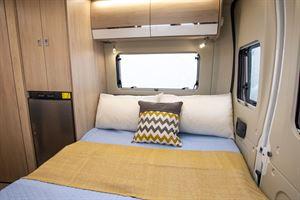 The bed in the Benivan 120 campervan