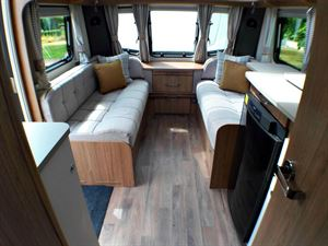 The kitchen and lounge of the Coachman VIP 460