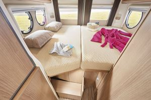 The double bed in the Malibu 600 DB Charming Coupe motorhome