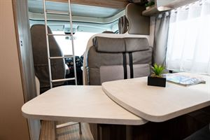 The extended table in the Benimar Primero 313 motorhome