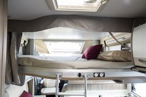 The drop down bed in the front of the Benimar Tessoro 482 motorhome