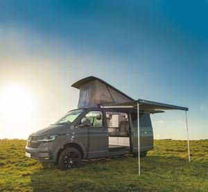 With the pop-top roof up and awning extended