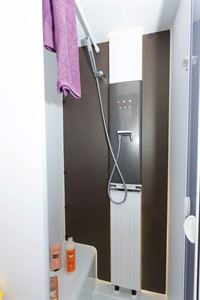 The bar-style towel rail and panel radiator