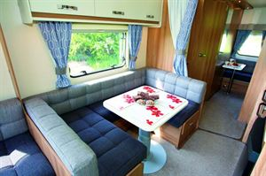 A big dining area in the centre of the caravan - and a small one at the rear!