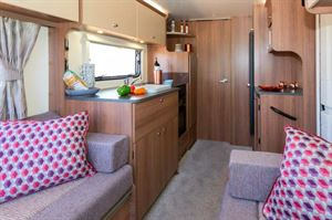 A caravan of two halves, with a bedroom and washroom at the rear.
