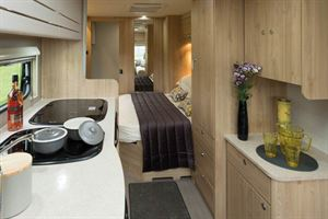 The Xplore 554's cosy bedroom beyond the kitchen