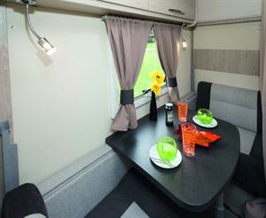 A cosy dining area for two. At night, convert it into bunks.