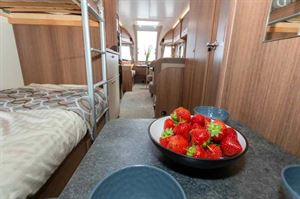 A dining table for children next to the bunks