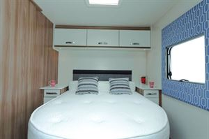 A gorgeously modern and cosy bedroom; the bed is 1.85m long