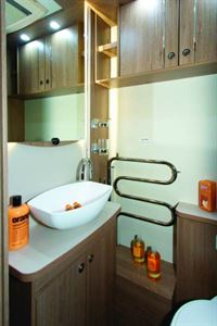 A heated towel rail and enough surfaces in the washroom