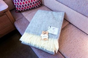 A high-quality woollen throw is part of the options pack