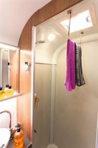A hinge-down towel rail - simple, and brilliantly practical!