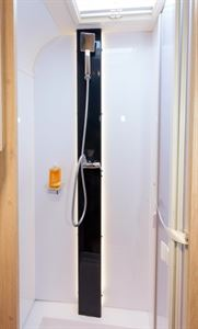 A large, square shower rose and a smart, black panel