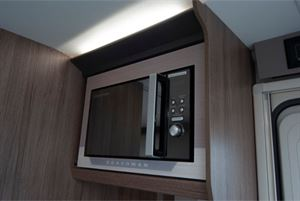 A mirror-fronted microwave