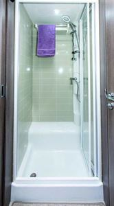 The shower cubicle and towel rail