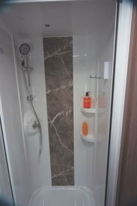 A stone effect panel in the shower is new