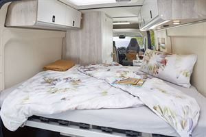 The double bed in the the Westfalia Amundsen 600D campervan