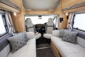 A view of the cab and the side-facing sofas in the Elddis Autoquest 194 motorhome