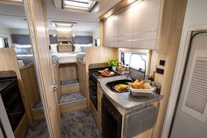Showing the kitchen and bedroom in the Elddis Autoquest 194 motorhome