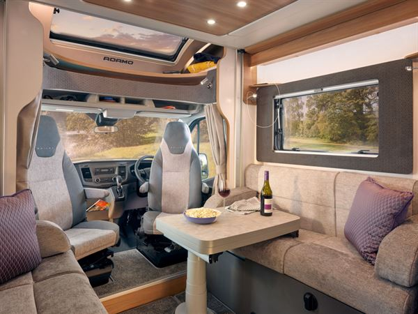 The Adamo 75-4DL flexi lounge, featuring twin aguti convertible travelling seats and electric multi-directional table