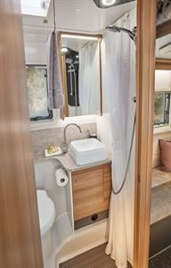 Adamo 75-4DL mid washroom featuring vanity cupboard with mirrored door and toothbrush holder