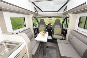 Adria Compact interior showing lounge and cab