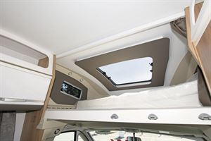 The raised bed in the Adria Coral XL Plus 600 DP motorhome