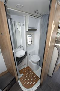 Wall moved aside to show the washroom in the Adria Matrix Axess 600 SC motorhome