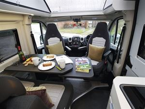 The lounge and cab in the Adria Twin Supreme 640 SGX campervan