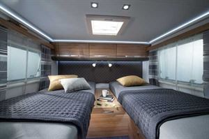 The Adria Matrix 670 SL's twin single beds