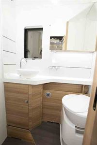 The washroom includes a sliding vanity cabinet  © Warners Group Publications