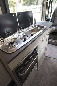 The kitchen, with two-burner hob, in the Auto-Trail Adventure 65 campervan