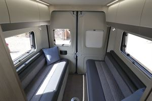 The rear lounge, with side-facing sofas, in the Auto-Trail Adventure 65 campervan