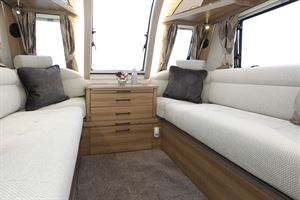 Comfortable settees in the living area in the Bailey Alicanto Grande Faro caravan
