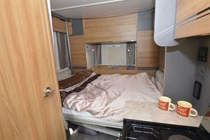 The rear lounge bed in the Bailey Adamo 75-4DL motorhome