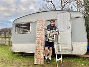 Charlie with the caravan's new bunk bed
