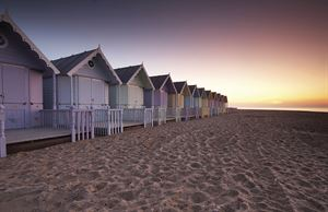 Beach huts on Mersea Island. Image: Alamy