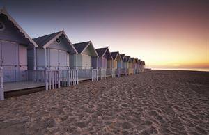 Beach huts on Mersea Island. Image: Alamy
