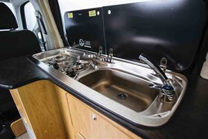 A close-up look at the sink and two burner hob